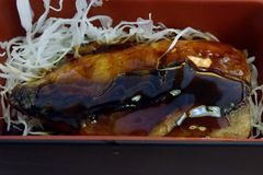 Japanese food, grilled soba fish in a box. royalty free stock photography