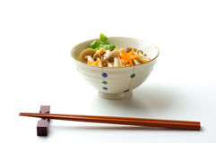 Japanese food, kinoko-gohan. Steamed rice with mushrooms on white background Royalty Free Stock Photo
