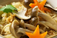 Japanese food, kinoko-gohan. Steamed rice with mushrooms shimeji and shiitake Royalty Free Stock Photography