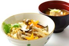 Japanese food, kinoko-gohan. Steamed rice with mushrooms on white background Stock Image