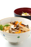 Japanese food, kinoko-gohan. Steamed rice with mushrooms on white background Royalty Free Stock Images