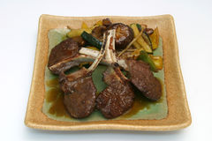 Japanese food. Lamb chops with vegetables on a square plate Royalty Free Stock Photo