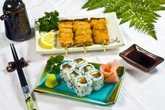 Japanese Food,  Menu maki. Japanese Food,  Menu of 6  California Maki & 3 Grilled Salmon Skewers PS-47940 Royalty Free Stock Photography