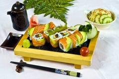 Japanese Food,  Menu maki. Japanese Food,  Menu of 12 Tuna, Salmon, Cucumber Maki PS-47934 Stock Photos