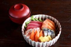 Japanese food mix raw fish on sushi rice. Mix raw fish on sushi rice , japanese foood with soup in wood background Stock Image