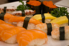 Japanese food mix sushi. Fish wheel water victuals unite turn sway shuhi spin salmon rotation roller Royalty Free Stock Images