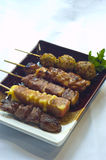 Japanese Food, Mixed Grilled Skillers. Japanese Food Mixed Grilled Skillers, Cheese, Meat Balls Royalty Free Stock Photos