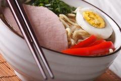 Japanese food: noodles ramen with pork and egg macro. horizontal Royalty Free Stock Photos