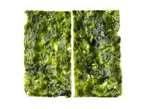 Japanese food nori dry seaweed sheets with salt and chopsticks. On white background royalty free stock photography