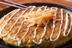 Japanese food: okonomiyaki on a plate macro. horizontal Royalty Free Stock Photo