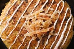 Japanese food: okonomiyaki on a plate macro. horizontal top view Royalty Free Stock Image