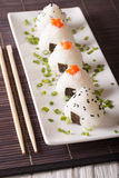 Japanese food onigiri rice balls close-up on a plate. Vertical Royalty Free Stock Photo