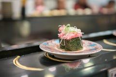 Japanese food parcel. Sushi on rotational belt Royalty Free Stock Photos