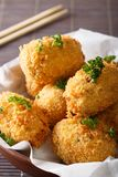 Japanese food: potato croquettes close-up. vertical Stock Image