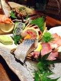 Japanese food with raw fish. Japanese food with raw fresh fish Royalty Free Stock Photo