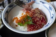Japanese food red caviar with rice and sashimi on a plate royalty free stock photography