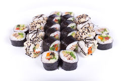 Japanese food restaurant, sushi maki gunkan roll plate or platter set. California  rolls with salmon.  isolated at white Stock Images
