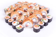 Japanese food restaurant, sushi maki gunkan roll plate or platter set. California  rolls with salmon.  isolated at white Stock Photos