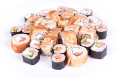 Japanese food restaurant, sushi maki gunkan roll plate or platter set. California  rolls with salmon.  isolated at white Royalty Free Stock Images