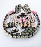 Japanese food restaurant, sushi maki gunkan roll plate or platter set. Sushi set and composition. Sushi set and composition at white background. Japanese food stock photos