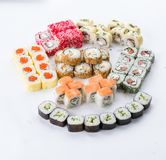 Japanese food restaurant, sushi maki gunkan roll plate or platter set. Sushi set and composition. Sushi set and composition at white background. Japanese food stock images
