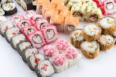 Japanese food restaurant, sushi maki gunkan roll plate or platter set. Sushi set and composition. Sushi set and composition at white background. Japanese food stock photo