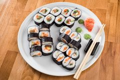 Maki Sushi rolls with salmon and avocado. Sushi isolated at white background. close up royalty free stock photo