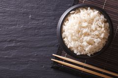 Japanese food: rice in a black bowl horiozntal top view Royalty Free Stock Photography