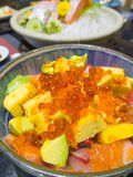 Japanese food, rice with seafood suchi and avocado Stock Photo