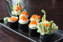 Japanese food roll sushi salmon egg on top Stock Photos