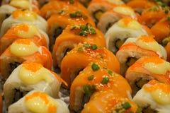 Japanese food Row of salmon sushi. Food Row of salmon sushi royalty free stock images