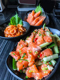 Japanese food salmon tataki spicy salmon salad with salmon sashimi fresh raw salmon meat and hotate kimuchi  spicy boiled sca. Llop with kimchi sauce as a Royalty Free Stock Photos