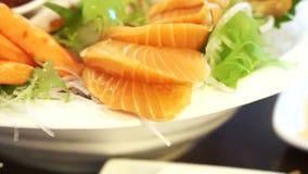 Japanese food set cooked and raw, sashimi and aburi stock video footage