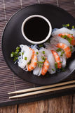 Japanese food: Shirataki with prawns, spring onions and soy sauc. E on a plate close-up. vertical view from above Royalty Free Stock Images