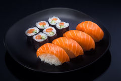Japanese Food shush. Fresh Japanese Food shushi on black plate Royalty Free Stock Photo
