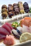 Japanese Food, Skewers Sashimi. Japanese Food,  Mixed Menu of Skewers Yakitori and Sashimi ,PS-42233 Royalty Free Stock Photography