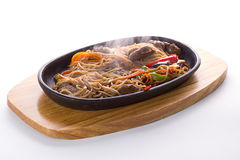 Japanese food: Soba noodles with meal and vegetables Royalty Free Stock Image