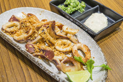 Japanese food. Squid sauteed with garlic. Serve with mashed onion in the oil and cream Stock Image