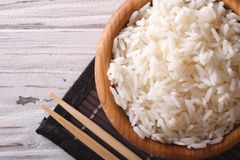 Japanese food: steamed rice in a wooden bowl top view Royalty Free Stock Photos