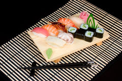 Japanese food on striped  mat. Nigiri-Sushi, sushi-mi on striped  mat Stock Images