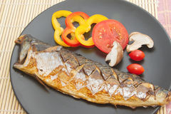 Saba fish grilled the plate Royalty Free Stock Image