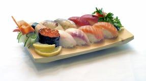 Japanese Food, Sushi. Japanese Food on a Wooden Platter, Mixed Sushi, Salmon, Tuna, Daurade, Salmon Eggs Stock Photo