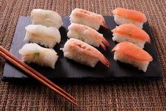 Japanese food sushi black slate chopsticks bamboo mat. Japanese food sushi black slate chopsticks Stock Photo