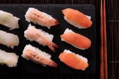 Japanese food sushi black slate chopsticks top view. Japanese food sushi black slate chopsticks Stock Photography