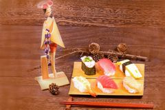 Japanese food ,sushi with chopsticks on wooden table wall backgr stock image
