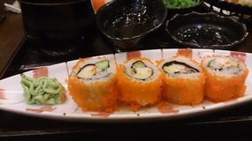 Japanese Food - Sushi. Sushi (??, ??, ?) is a Japanese food consisting of cooked vinegared rice (??, ... Raw fish (or occasionally other meat) sliced and served Royalty Free Stock Photos