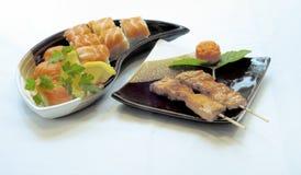 Japanese Food, Sushi Maki. Japanese Food,  Salmon Maki and Sushi, with Grilled Salmon Yakitori Royalty Free Stock Photography