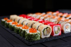 Japanese food, sushi restaurant. Close up of great assortment of. Tasty multicolored maki sushi rolls, selective focus royalty free stock image