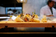 Sushi rolls on the wooden plate. Japanese food , Sushi rolls on the wooden plate in restaurant background Stock Photography
