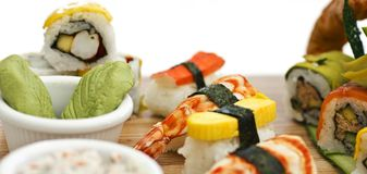 Japanese food - Sushi, sashimi, rolls on a wooden board. Isolate. Japanese food - Sushi, sashimi, rolls on the wooden board Royalty Free Stock Images